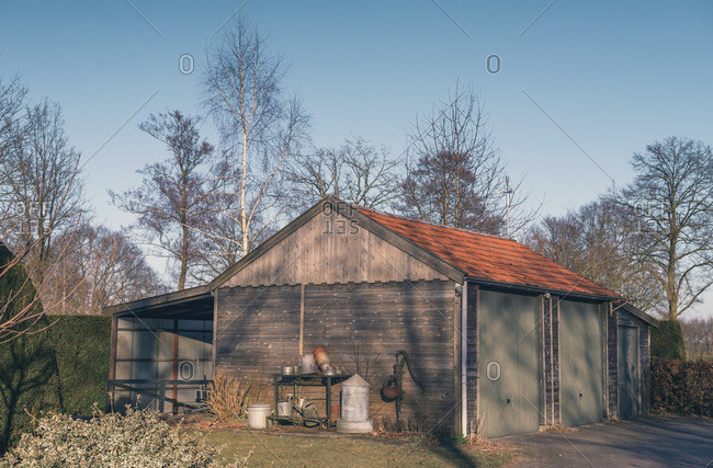 Wooden shed in sunny winter backyard