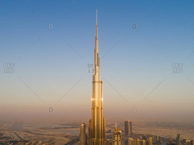 Dubai, UAE - June 17, 2017: Aerial view of bright Burj Khalifa tower in the sky