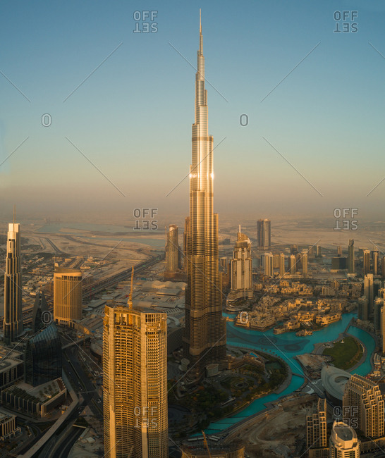 Dubai, UAE - June 17, 2017: Aerial view of bright Burj Khalifa tower, park and fountain in downtown