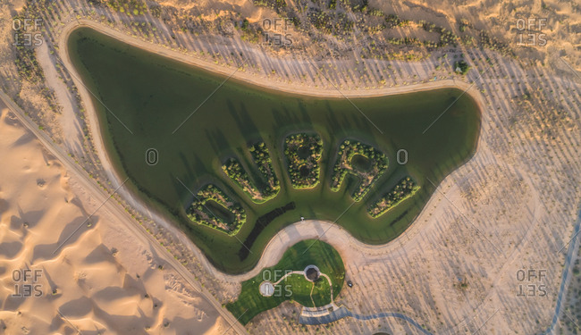 Aerial view of an artificial lake in the desert of Dubai, UAE