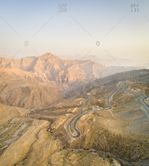 Aerial view of serpentine road in Jebel Jais rocky mountains in Ras Al Khaimah, UAE