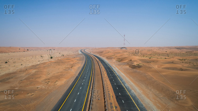 Aerial view of an empty road in the Sharjah desert, UAE