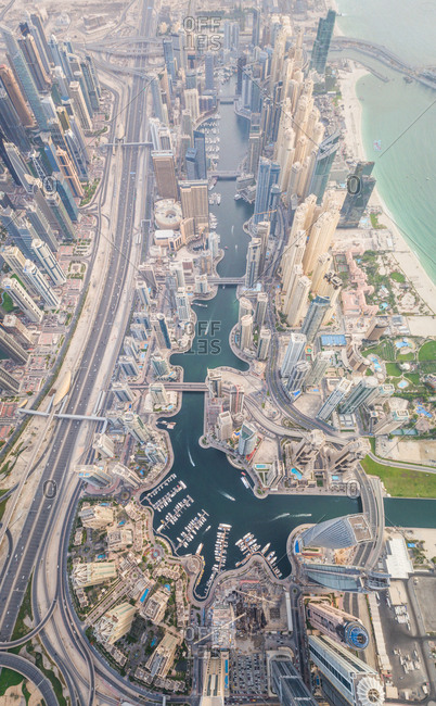 Aerial view of towers surrounding harbour in Dubai canal, UAE