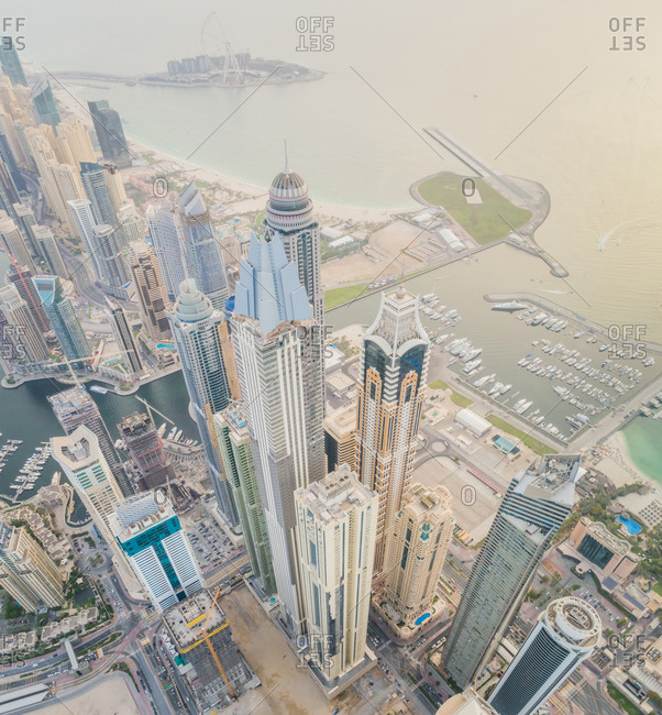 Aerial view of towers surrounding harbour in Dubai Marina, UAE