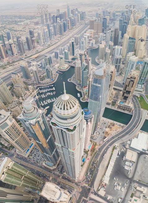 Aerial view of towers surrounding harbour in Dubai Marina, UAE