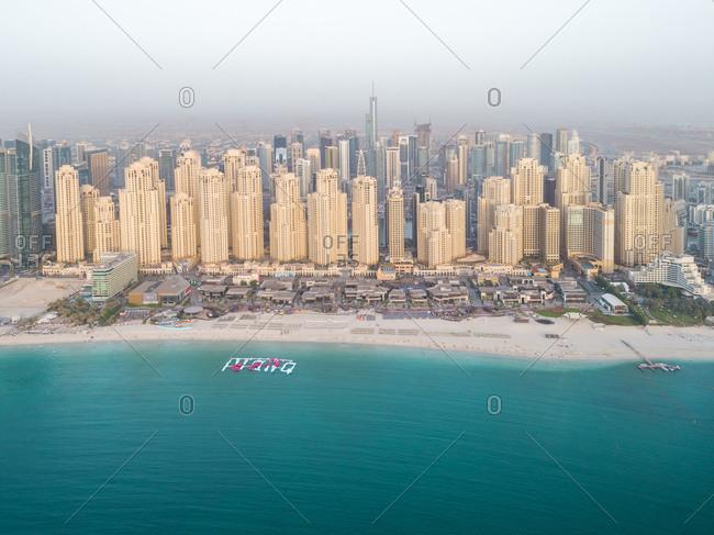 Aerial view of skyscrapers surrounding the beach in Dubai, UAE