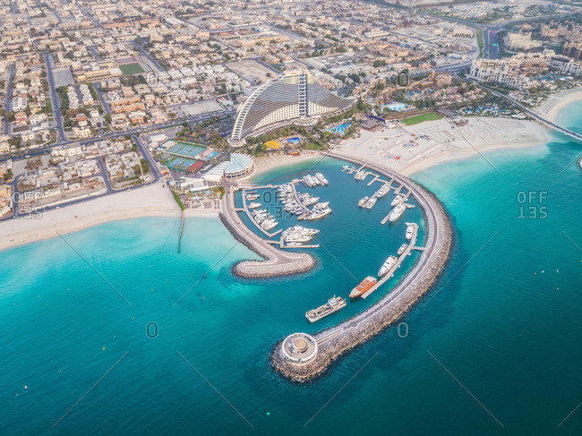 Aerial view of luxurious yatch moored in an harbour in Dubai, UAE