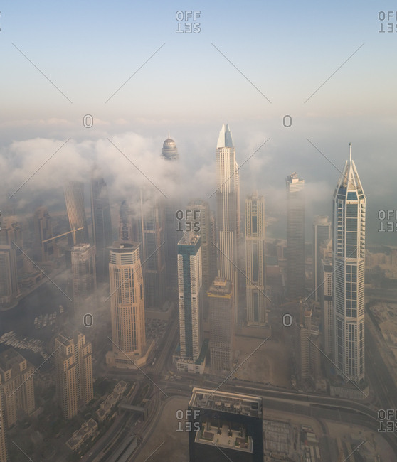 Aerial view of skyscrapers touching the clouds in Dubai, United Arab Emirates