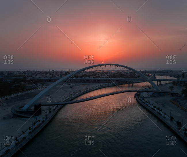 Aerial view of the Tolerance pedestrian Bridge in Dubai at sunset, UAE