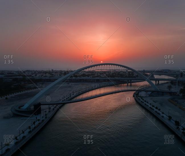 Aerial view of the Tolerance pedestrian Bridge in Dubai at sunset, UAE