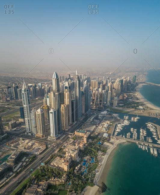 Aerial view of skyscrapers and bay of Dubai, UAE