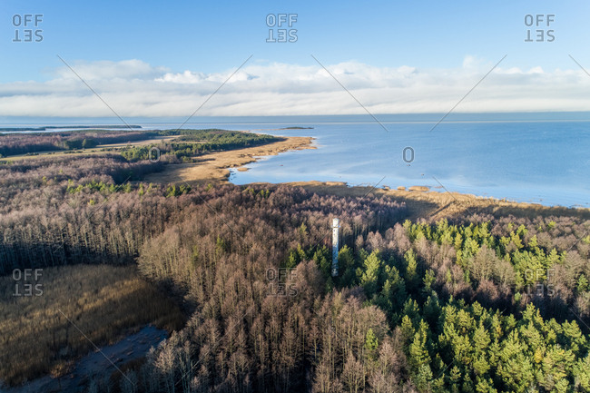 Aerial view of Norrby alumine tuletorn lighthouse in the forrest on the coast of Vormsi Island, Estonia