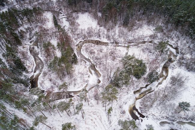 Aerial view of Vaana Jogi serpentine river surrounded by snow in winter in Estonia