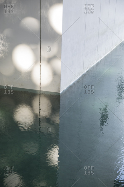 Abu Dhabi, United Arab Emirates - February 10, 2018: Corner angle falling into water feature at the Louvre in Abu Dhabi