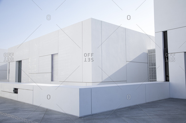Abu Dhabi, United Arab Emirates - February 10, 2018: View of clean lines of exterior space of Louvre in Abu Dhabi