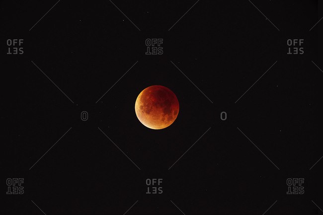The moon in early stages of totality during total lunar eclipse