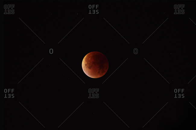 The moon in middle stages of totality during total lunar eclipse