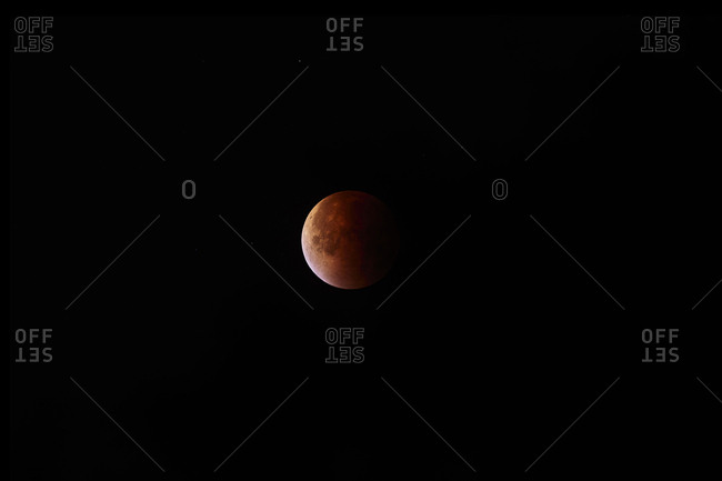 The moon in later stages of totality during total lunar eclipse