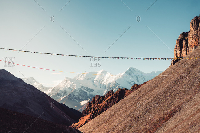 Prayer flags hung across mountain slopes