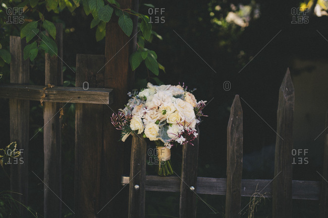 Wedding bouquet still life on rustic wooden fence