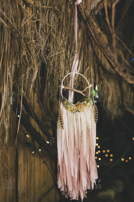 Wedding decor still life of dreamcatcher hanging on fence line