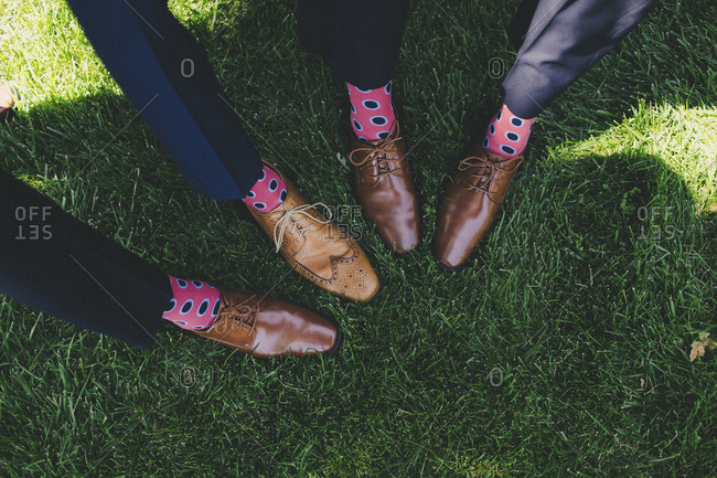 Groomsmen feet posed in formation to show off matching bright socks