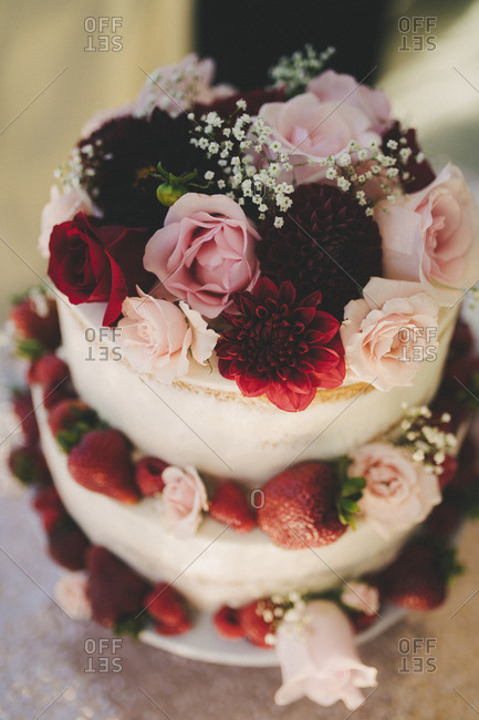 High angle close-up top tier view of floral decorated wedding cake