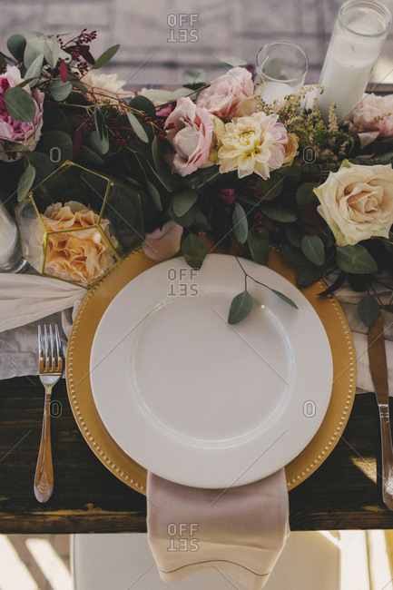 Flowery bohemian wedding reception table setting from above