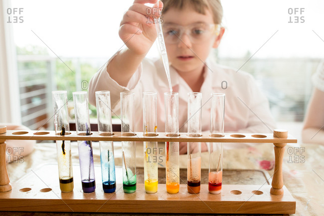 Young student engaged in colorful science experiment