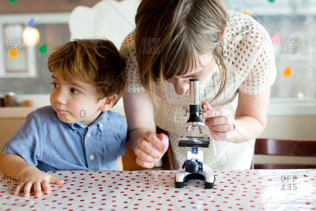 Mom looking through microscope son was playing with