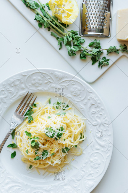 Finished lemon pasta recipe next to ingredients on counter