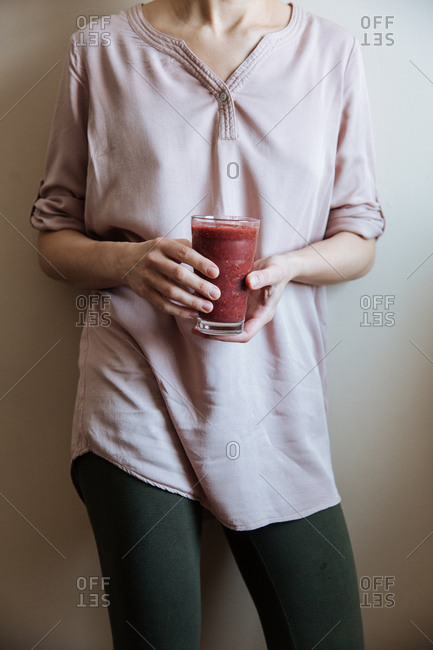 Woman ready for post workout smoothie made from scratch