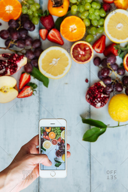 Top view of smartphone capturing commercial produce photography