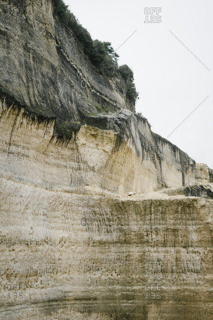 View of weathered limestone cliff along coast of Bali, Indonesia