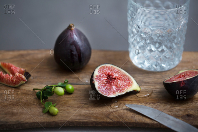 Fresh figs served on wooden cutting board