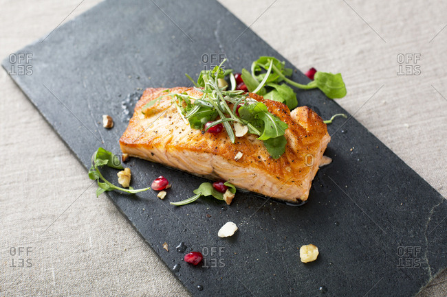 Salmon fillet topped with fresh arugula