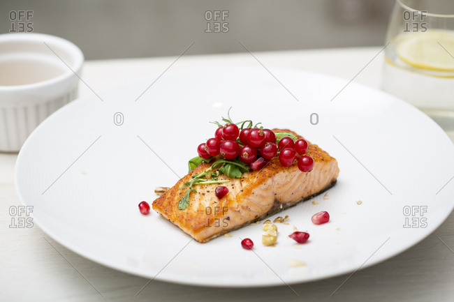 Salmon fillet topped with lingonberries