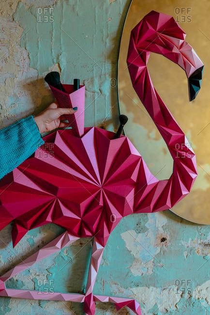 Origami flamingo bird made as home decoration shelf and a mirror