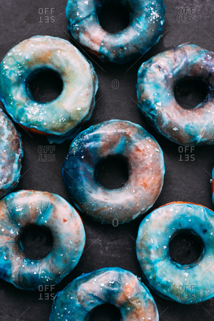 Donuts pattern glazed with blue and white sugar looking galactic