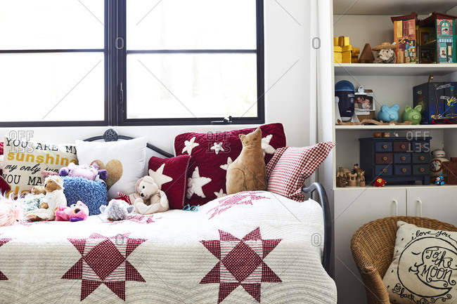 Los Angeles, California, USA - March 9, 2018: Daybed with throw pillows, stuffed animals, and quilt