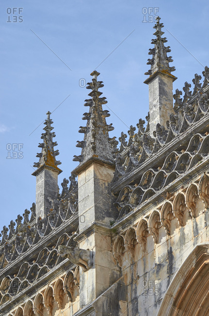 Details of gothic carvings on facade of Batalha monastery in Portugal