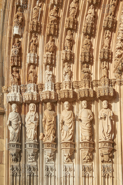Detail of carved figures in archivolts of main portal of Batalha Monastery in Portugal