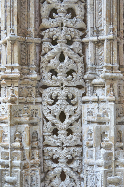 Detail of complex carvings in pillar in facade of Batalha monastery in Portugal