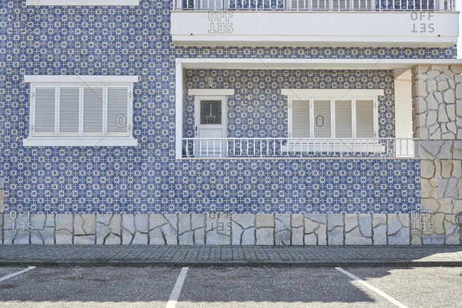 Moorish tiles decorate the facade of a mid century modern apartment building