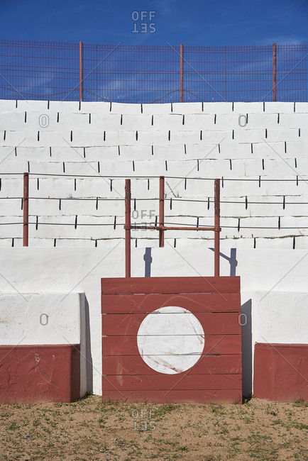 Close up of screen in front of barrier where matador can shelter in bullfighting arena in Sousel, Portugal