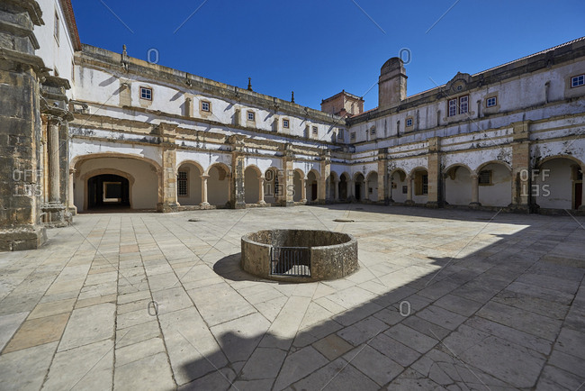 View across austere courtyard of Convent of Christ in Tomar, Portugal