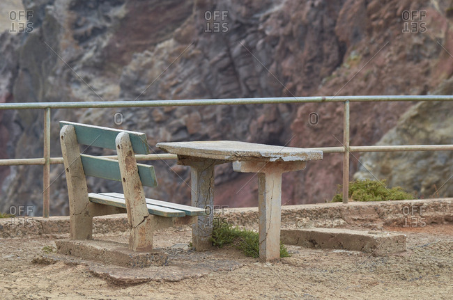 Weather beaten bench and table for hikers to rest