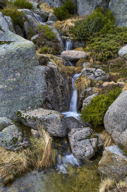 Long exposure image of stream cascading over rocks