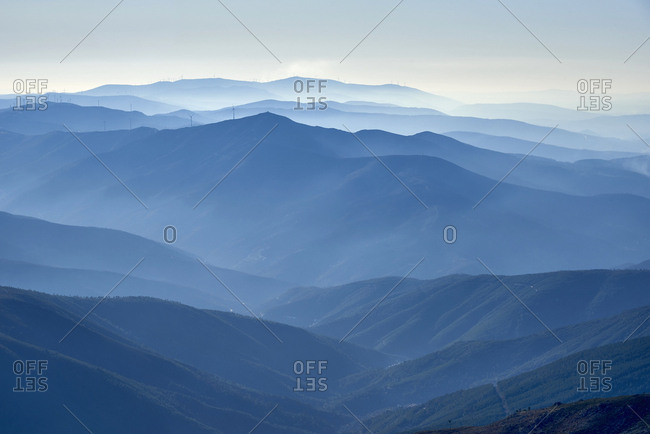 Looking out over fog shrouded peaks and valleys of Serra da Estrela mountains in Portugal