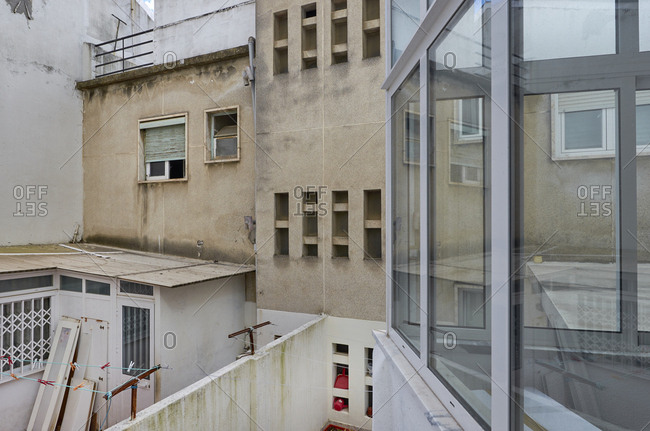 Drab unused space between and behind buildings in Lisbon, Portugal